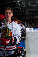 KELOWNA, CANADA - OCTOBER 20: Brad Ginnell #27 of the Portland Winterhawks stands on the bench for the national anthem against the Kelowna Rockets on October 20, 2017 at Prospera Place in Kelowna, British Columbia, Canada.  (Photo by Marissa Baecker/Shoot the Breeze)  *** Local Caption ***