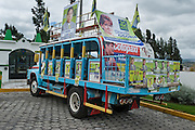 In Latacunga, Ecuador, a bus/truck proclaims political slogans, banners and pictures.