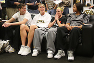 Wendy Ausdemore (from left), Kelsey Cermak, Kristi Smith, and Shante Jones talk after hearing they will host Georgia Tech in the first round while watching the NCAA Women's Basketball Selection Show on ESPN in their locker room at Carver-Hawkeye Arena in Iowa City on Monday March 16, 2009.