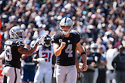 Oakland Raiders quarterback Derek Carr (4) celebrates a touchdown against the Atlanta Falcons at Oakland Coliseum in Oakland, Calif., on September 18, 2016. (Stan Olszewski/Special to S.F. Examiner)