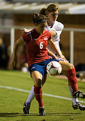 Liberty Flames defender Emily House (6) fends off Virginia Cavaliers defender/forward Molly McKeon (3).  The Virginia Cavaliers defeated the Liberty Flames 5-0 in women's soccer at Klockner Stadium on the Grounds of the University of Virginia in Charlottesville, VA on August 29, 2008.