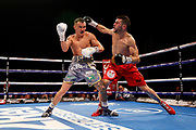 Sofiane Takoucht throws a punch at Josh Warrington during the Josh Warrington Sofiane Takoucht IBF featherweight title fight at First Direct Arena, Leeds, United Kingdom on 12 October 2019.