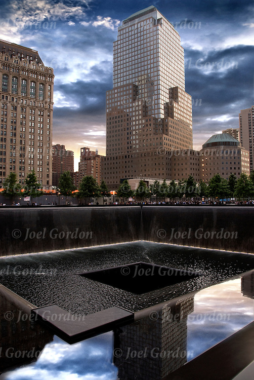 The memorial occupies half of the 16-acre World Trade Center site. Twin reflecting pools with cascading waterfalls are set within the one-acre footprints of the original twin towers. <br /> <br /> It is 176 feet in perimeter, and the waterfalls are 30 feet deep from street level. <br /> <br /> The 2,983 names of the victims of the attacks of Sept. 11, 2001, and Feb. 26, 1993, World Trade Center truck bombing are inscribed into bronze parapets surrounding the twin memorial pools.