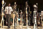 A man walks past large bronze statues at the Village Artisanal de Ouagadougou, a cooperative that employs dozens of artisans who work in different mediums, in Ouagadougou, Burkina Faso, on Monday November 3, 2008.