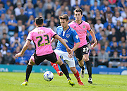 Portsmouth midfielder Ben Close takes on Northampton Town Midfielder Danny Rose during the Sky Bet League 2 match between Portsmouth and Northampton Town at Fratton Park, Portsmouth, England on 7 May 2016. Photo by Adam Rivers.