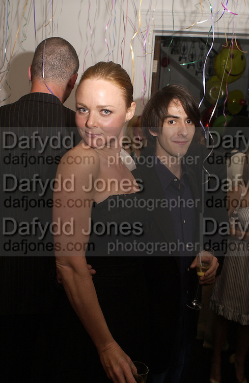 Stella McCartney and Dhani Harrison, Stella McCartneys's birthday party for her shop, Bruton st. 26 May 2004. ONE TIME USE ONLY - DO NOT ARCHIVE  © Copyright Photograph by Dafydd Jones 66 Stockwell Park Rd. London SW9 0DA Tel 020 7733 0108 www.dafjones.com