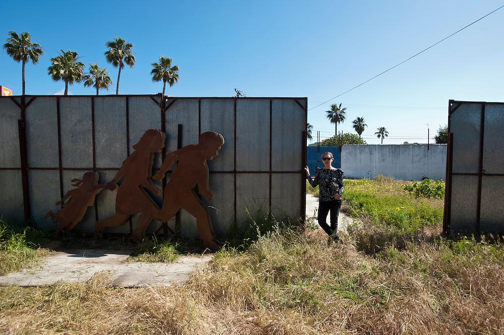 Jean Von Borstel, artist in Playas Tiuana, with an iron and wood sculpture in Playas Tijuana, Mexico...© Stefan Falke.http://www.stefanfalke.com/..