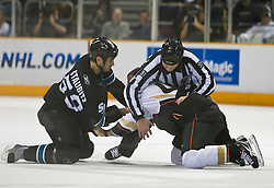 January 21, 2010; San Jose, CA, USA; San Jose Sharks right wing Brad Staubitz (59) and Anaheim Ducks defenseman Nick Boynton (4) have their fight during the first period broken up by linesman Don Henderson (91) at HP Pavilion. San Jose defeated Anaheim 3-1. Mandatory Credit: Jason O. Watson / US PRESSWIRE