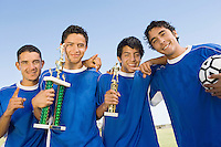Soccer Players Holding Trophies