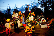 An early El Día de los Muertos celebration in the cemetery of Xoxocotlán, a village outside of Oaxaca, Mexico October 31, 2009.
