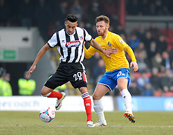 Bristol Rovers' Matty Taylor challenges Grimsby's Nathan Arnold - Photo mandatory by-line: Neil Brookman/JMP - Mobile: 07966 386802 - 14/02/2015 - SPORT - Football - Cleethorpes - Blundell Park - Grimsby Town v Bristol Rovers - Vanarama Football Conference