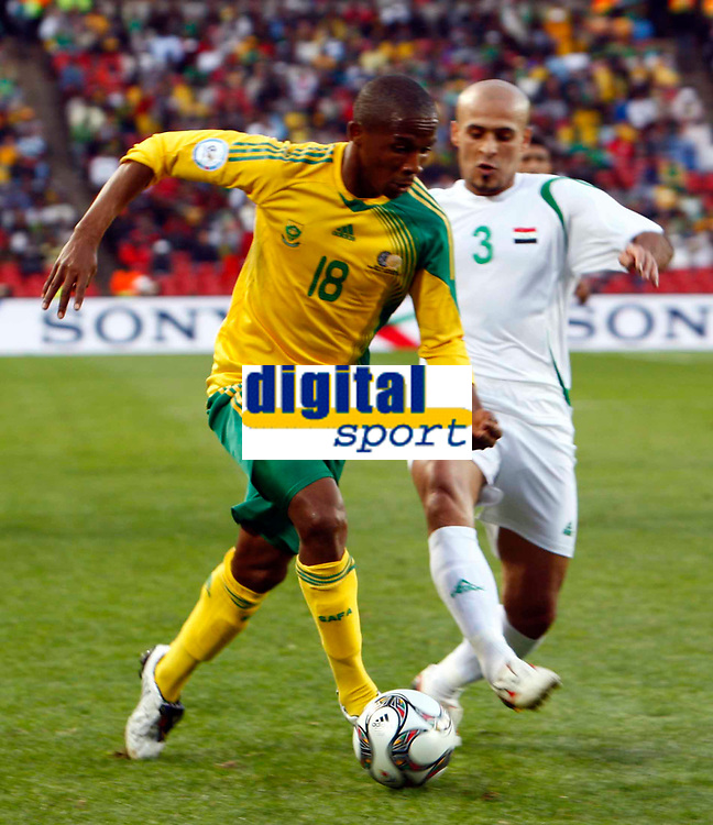 Thembinkosi Fanteni  of South Africa Basem Abbas of Iraq FIFA Confederations Cup South Africa 2009  South Africa  v Iraq at Coca Cola Park ( Ellis Park )  Stadium <br /> 14/06/2009 Credit Colorsport / Kieran Galvin