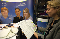 © under license to London News Pictures. 17/11/2010. Delegates check the agenda over lunch at The Royal College of Midwives' conference, in Manchester