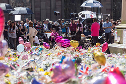 &copy; Licensed to London News Pictures. 26/05/17  MANCHESTER   , UK. <br />  <br /> A sea of flowers and balloons in St Ann's Square , Manchester , today (Friday 26th May 2017) as people gather to remember the victims of the terrorist bomb attack on Monday at the Manchester Arena.  Members of the media broadcast from the square.<br />   <br /> Photo credit: CHRIS BULL/LNP