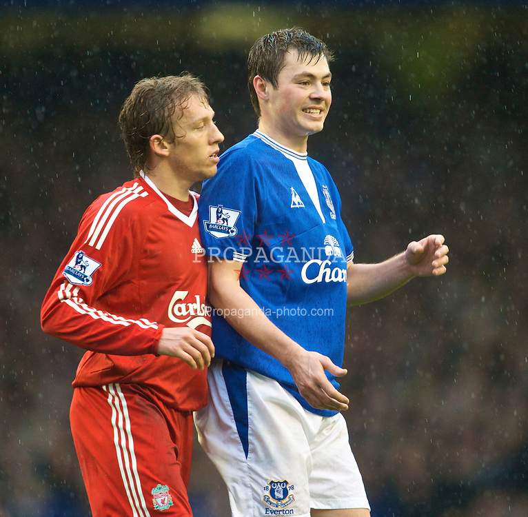 LIVERPOOL, ENGLAND - Sunday, November 29, 2009: Liverpool's Lucas Leiva and Everton's Diniyar Bilyaletdinov during the Premiership match at Goodison Park. The 212th Merseyside Derby. (Photo by David Rawcliffe/Propaganda)