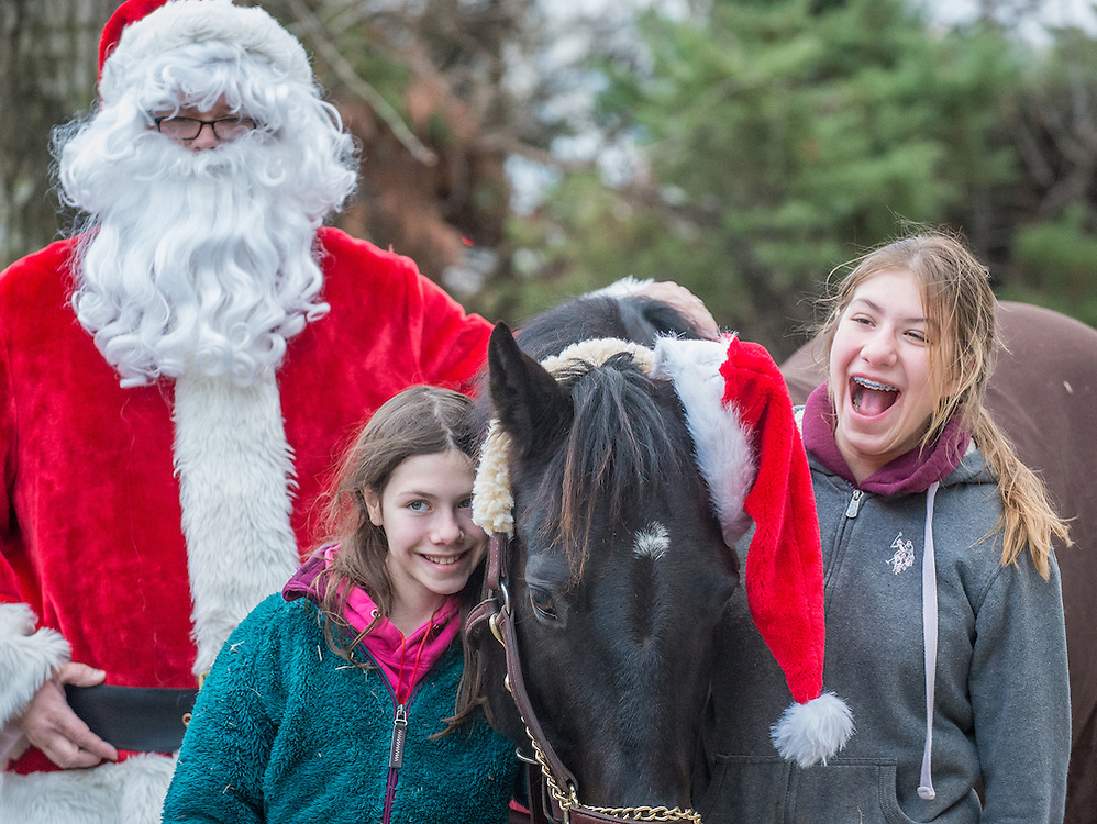 Emma and Caitlin Sottile with their horse Lexus, with Santa Sunday for Pets at the Bristol County Visitor Center in Bensalem, Pa, Sunday, December 14, 2014.  Photo by Bryan Woolston / @woolstonphoto.