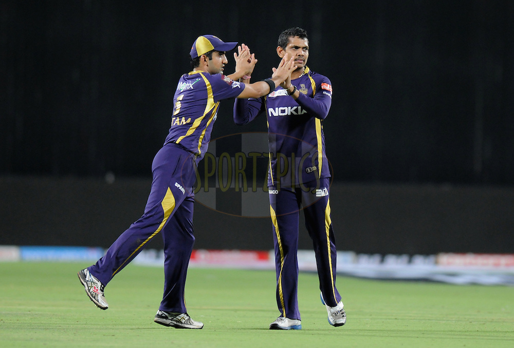Gautam Gambhir captain of Kolkatta Knight Riders celebrate a wicket with teammate Sunil Narine of Kolkatta Knight Riders during the first Qualifying match of the Indian Premier League ( IPL) 2012  between The Delhi Daredevils and The Kolkata Knight Riders held at the Subrata Roy Sahara Stadium, Pune on the 22nd May 2012..Photo by Pal Pillai/IPL/SPORTZPICS
