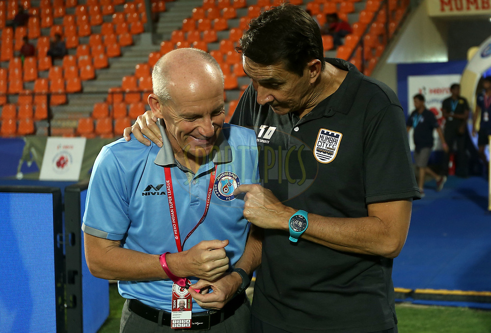 Jamshedpur FC coach Steve Coppell and Mumbai City FC coach Alexandre Guimaraes before the start of the match 61 of the Hero Indian Super League between Mumbai City FC and Jamshedpur FC held at the Mumbai Football Arena, Mumbai India on the 1st Feb  2018<br /> <br /> Photo by: Sandeep Shetty  / ISL / SPORTZPICS