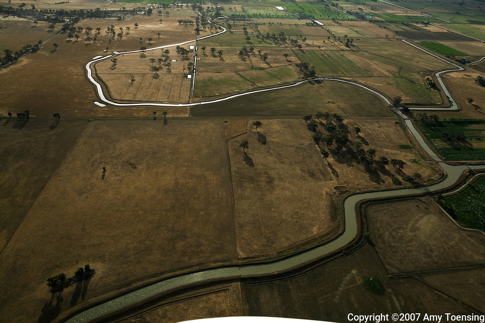 SHEPPARTON, VIC, AUSTRALIA - OCTOBER 29: Dairy farms using Murray River water for irrigating fields October 29, 2007 in Shepparton, Victoria. The Murray-Darling Basin in southeast Australia has been plagued with severe drought since the late 1990's and many growers and policy makers are being forced to work on implementing more efficient irrigation systems. (Photo by Amy Toensing / Reportage by Getty Images). _________________________________<br /> <br /> For stock or print inquires, please email us at studio@moyer-toensing.com.