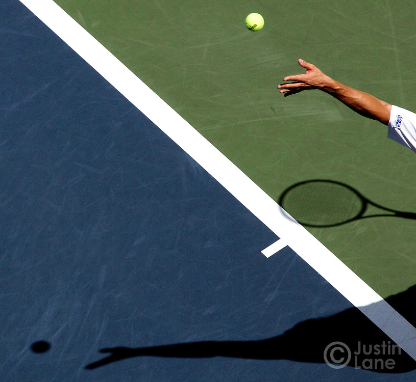 The hand of tennis player David Ferrer tosses a ball to serve during the third round of the 2005 US Open Tennis Tournament Sunday 4 September 2005 in New York.