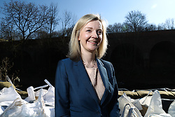 © Licensed to London News Pictures. 17/03/2016. Leeds, UK. Elizabeth Truss, Secretary of State for Environment, Food and Rural Affairs, next to huge sad bags that act as flood defences next to the River Aire in Leeds. The minister was on a visit to the Kirkstall area of Leeds, West Yorkshire, which was heavily affected by flooding earlier this year. Truss was waving the flag for flood defence spending after George Osborne announced £700 million would be spent on flood defences in his budget yesterday. Photo credit : Ian Hinchliffe/LNP
