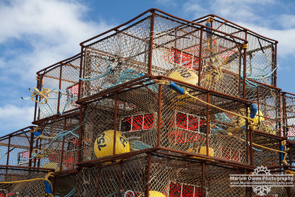 "Stack of King crab pots rigged with orange ""triggers"" for Pacific cod fishery, in Kodiak, Alaska."