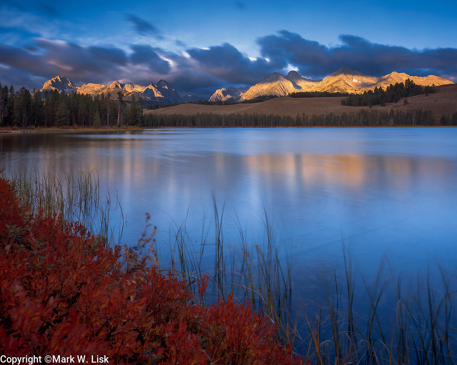 The granite peaks of the Sawtooth Range reflect into Little Redfish Lake in the Sawtooth Wilderness.