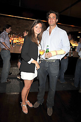 LADY NATASHA RUFUS-ISAACS and RUPERT FINCH at the launch party of the new Embargo 59 nightclub at 533 Kings Road, London on 25th June 2009.