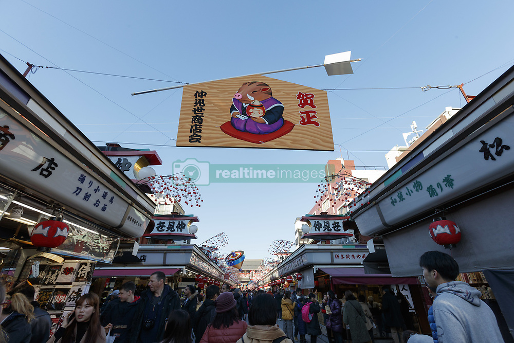 December 17, 2018 - Tokyo, Japan - Foreign tourists gather at Nakamise Shopping Street in Asakusa district. This year the number of foreign tourists visiting Japan is expected to exceed 30 million for the first time ever, said on Friday, the Japanese tourist agency. The government has set a target to attract 40 million overseas tourists in 2020, the year of the Tokyo Olympic Games. (Credit Image: © Rodrigo Reyes Marin/ZUMA Wire)