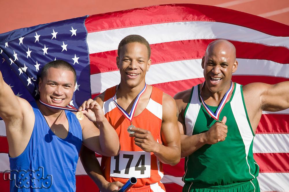 Three male athletes enjoying victory, portrait