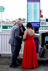 Racegoers place bets during Grand National Day of the 2018 Randox Health Grand National Festival at Aintree Racecourse, Liverpool.