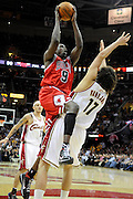 Apr 19, 2010; Cleveland, OH, USA; Chicago Bulls forward Luol Deng (9) runs into Cleveland Cavaliers center Anderson Varejao (17) during the fourth period in game two in the first round of the 2010 NBA playoffs at Quicken Loans Arena. The Cavaliers beat the Bulls 112-102. Mandatory Credit: Jason Miller-US PRESSWIRE