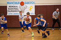 Gilford's Jackson Gelo tries to break away from Belmont's Jak Rogers during the 26th annual Memorial Francoeur Babcock Basketball Tournament Saturday afternoon at Gilford Middle School.  (Karen Bobotas/for the Laconia Daily Sun)