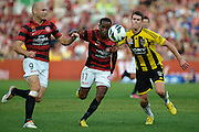 10.03.2013 Sydney, Australia. Wanderers Croatian forward Dino Kresinger and Wanderers Dutch midfielder Youssouf Hersi in action during the Hyundai A League game between Western Sydney Wanderers and Wellington Phoenix FC from the Parramatta Stadium. The Wanderers won 2-1.