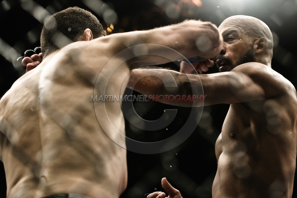 "BIRMINGHAM, ENGLAND, NOVEMBER 5, 2012: Anthony Perosh (left) throws an elbow to the jaw of Cyrille Diabate during ""UFC 138: Munoz vs. Leben"" inside the National Indoor Arena in Birmingham, United Kingdom"