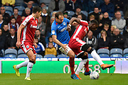 Brett Pitman (8) of Portsmouth battles for possession with Mikael Ndjoli (10) of Gillingham during the EFL Sky Bet League 1 match between Portsmouth and Gillingham at Fratton Park, Portsmouth, England on 12 October 2019.