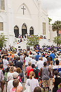 Residents gather for a memorial service for the Charleston Nine outside at the Mother Emanuel African Methodist Episcopal Church on the anniversary of the mass shooting June 18, 2016 in Charleston, South Carolina. Nine members of the church community were gunned down during bible study inside the church on June 17, 2015.