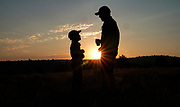 Keobs Avila (R) talks to Sielh Avila  at sunrise while waiting for the solar eclipse in Guernsey, Wyoming U.S. August 21, 2017.  REUTERS/Rick Wilking
