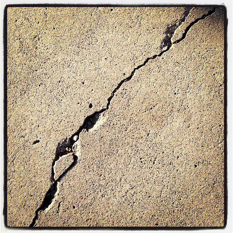 Hayward Fault: Up close view of a cracked sidewalk in downtown Hayward, CA. This crack is caused by the slow movement of the tectonic plates directly underneath this spot.