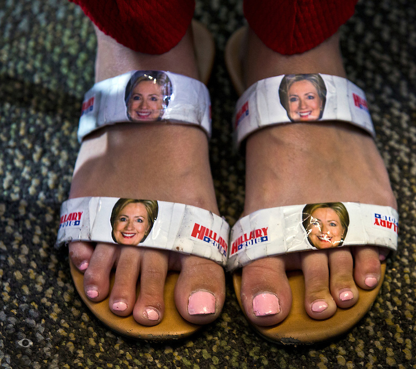 A Hillary Clinton supporter sports handmade shoes as President Bill Clinton campaigns on her behalf at the College of Southern Nevada on Wednesday, Sept. 14, 2016.