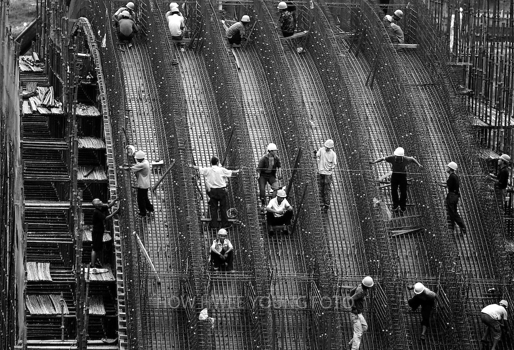 Workers working at the construction site of the Taocha canal head works, the 'tap' of the the channel transferring water from Danjiangkou reservoir to Beijing, part of the central route of the South-to-North Water Transfer project in Xichuan county of Henan Province in China on 27 June 2010. The South-to-North Water Transfer project, the largest known water diversion project, was conceived in 1952 to solve the country's chronic water shortages and involves creating three routes to channel 44.8 billion cu m of water from southern China to the northern areas. As part of the project's central route, affecting Henan and Hubei provinces, water from the Danjiangkou reservoir will be diverted to Beijing.