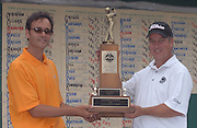Grand Traverse Resort pro Scott Hebert and Boyne Resorts Stephen Kircher hold the Tournament of Champions Trophy.