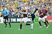 21.04.2013 Sydney, Australia. Wanderers Croatian forward Dino Kresinger and Mariners Daniel McBreen in action during the Hyundai A League grand final game between Western Sydney Wanderers FC and Central Coast Mariners FC from the Allianz Stadium.Central Coast Mariners won 2-0.