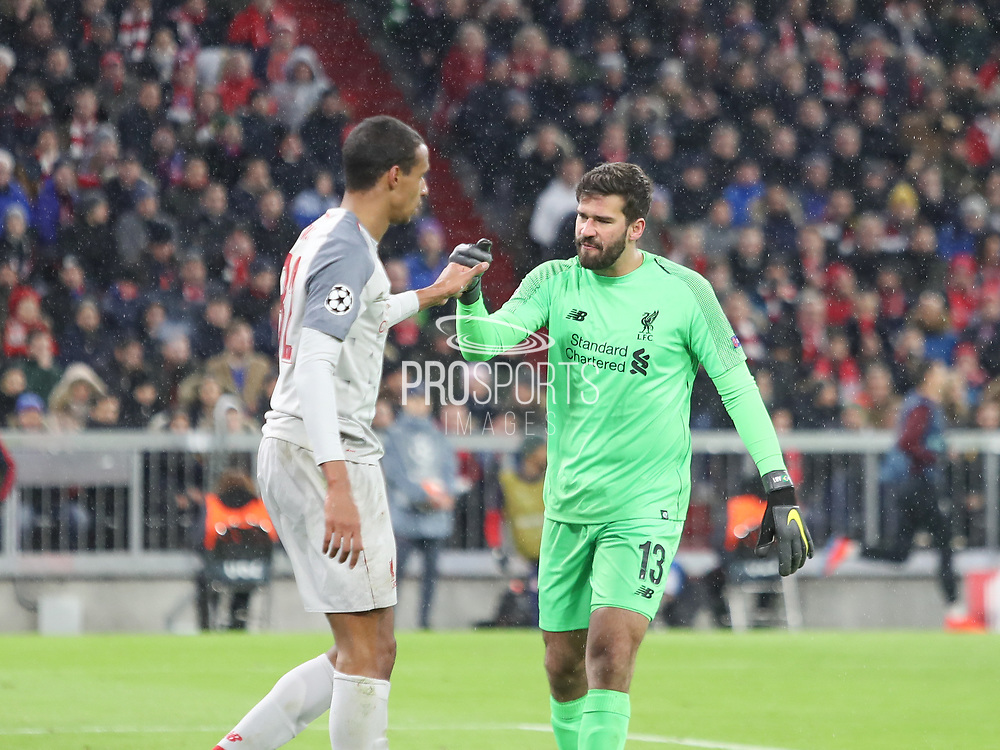 Alisson Becker and Joel Matip of Liverpool during the Champions League round of 16, leg 2 of 2 match between Bayern Munich and Liverpool at the Allianz Arena stadium, Munich, Germany on 13 March 2019.