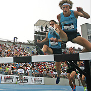 JAGER - 13USA, Des Moines, Ia. - Evan Jager clears a hurdle in the final lap of the steeplechase en route to his win.    Photo by David Peterson