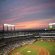 Sunset over Citi Field during the New York Mets Vs Chicago Cubs MLB regular season baseball game at Citi Field, Queens, New York. USA. 1st July 2015. Photo Tim Clayton