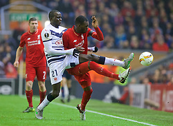 LIVERPOOL, ENGLAND - Thursday, November 26, 2015: Liverpool's Christian Benteke in action against FC Girondins de Bordeaux's Cedric Yambere during the UEFA Europa League Group Stage Group B match at Anfield. (Pic by David Rawcliffe/Propaganda)