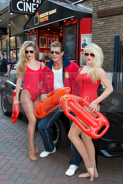 """© Licensed to London News Pictures. 18/05/2012. London, England. Photocall with U.S. American actor David Hasselhoff. Hasselhoff poses in Baywatch gear alongside KITT, the talking car from the series """"Knight Rider"""" which made him famous before performing a one-man show """"An Evening with David Hasselhoff Live"""" at the Leicester Square Theatre. Two performances in London (17/18th August) and from 21-27 August in Edinburgh. Photo credit: Bettina Strenske/LNP"""