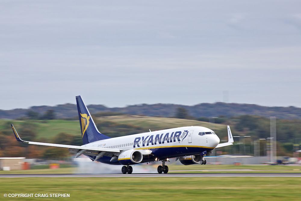 A Ryanair jet landing at Edinburgh aiport, Scotland, UK