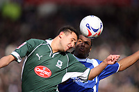 Lee Hodges of Plymouth and Cameron Jerome clash in the air Photo: Richard Eaton.<br /> <br /> Plymouth Argyle v Cardiff City. Coca Cola Championship. 18/03/2006.